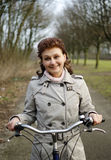 Happy woman riding a bicycle Royalty Free Stock Photos