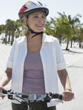 Happy Woman Riding Bicycle On Beach Stock Photos