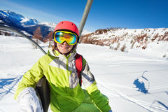 Happy woman riding to start of slope on chairlift Stock Images