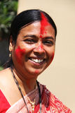 Happy Woman after ritualistic Vermilion play on Durga Puja Royalty Free Stock Photos