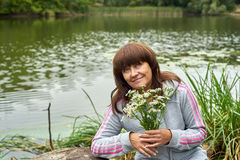 Happy woman on the river bank Stock Photography