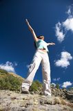 Happy woman on rock Royalty Free Stock Image
