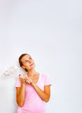 Happy woman with roller brush dreaming Royalty Free Stock Photography