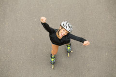Happy woman on roller skates Stock Image