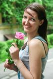 Happy woman with rose Royalty Free Stock Image