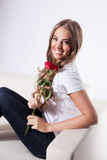 Happy woman with a rose Royalty Free Stock Photography