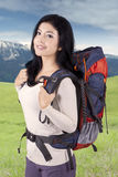 Happy woman with rucksack outdoors Royalty Free Stock Photo