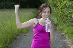 Happy woman runner cheering Royalty Free Stock Image