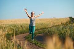 Happy woman runner raising arms winning royalty free stock photo