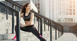 Happy woman runner stretching before training royalty free stock photography