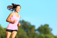 Happy woman running Stock Photography