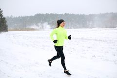 Happy woman running along snow covered winter road Stock Photography