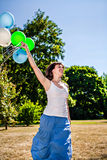 Happy woman running with balloons Royalty Free Stock Photography