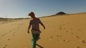 Happy woman running barefoot in desert, Egypt stock video