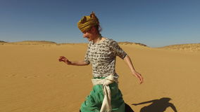 Happy woman running barefoot in desert, Egypt stock footage