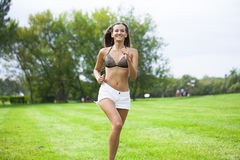 Happy Woman running Royalty Free Stock Image