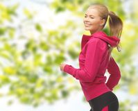 Happy woman running or jogging Stock Photos