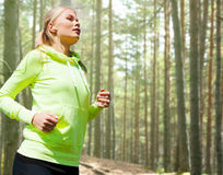 Happy woman running or jogging Stock Photography