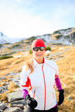 Happy woman running in mountains on winter fall sunny day Royalty Free Stock Photo