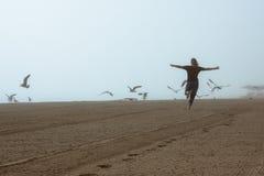 Free Happy Woman Running On The Beach Stock Photo - 41809660