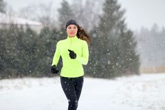 Happy woman running outdoors in winter Royalty Free Stock Photos