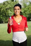 Happy woman running in park royalty free stock photos