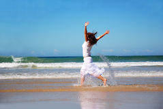 Happy woman running in sea Stock Photography