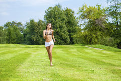 Happy Woman running on summer or spring grass field Royalty Free Stock Images