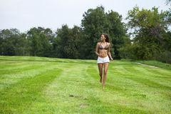 Happy Woman running on summer or spring grass field Royalty Free Stock Image
