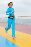 Happy woman runs on cruise liner deck Royalty Free Stock Photo