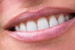 Happy woman's smile with healthy white teeth. Macro happy woman's smile with healthy white teeth, bright pink lips make-up Royalty Free Stock Photo