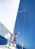 Happy woman on sailboat Stock Images
