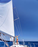 Happy woman on sailboat Royalty Free Stock Image
