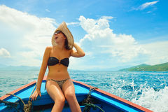 Happy woman sailing in boat on her summer holidays. Royalty Free Stock Image