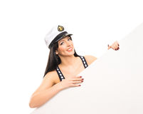 A happy woman in a sailor hat holding a white banner Royalty Free Stock Photo