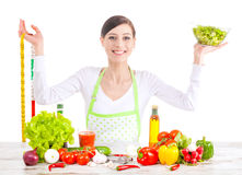 Happy woman with salad and measuring tape. Royalty Free Stock Photography