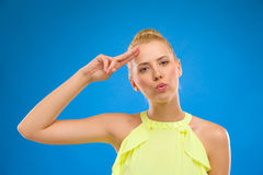 Happy woman saluting and whistling Royalty Free Stock Images