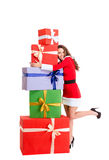 Happy woman in santa claus cloth hugging many gift boxes Stock Images