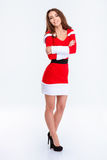 Happy woman in santa claus cloth standing with arms folded Royalty Free Stock Photography