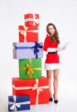 Happy woman in santa claus cloth using tablet compter Stock Photo