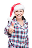 Happy woman in a Santa Claus hat in pajamas on a white Stock Image