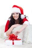 Happy woman in santa costume laying on sofa Stock Image