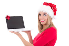 Happy woman in santa hat buying presents by internet Royalty Free Stock Photo