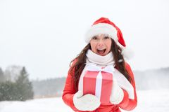 Happy woman in santa hat with chrismas gift Royalty Free Stock Photo