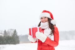 Happy woman in santa hat with chrismas gift Stock Image