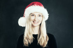 Happy Woman in Santa Hat. Christmas Stock Photography