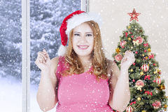 Happy woman with santa hat in christmas day Stock Images
