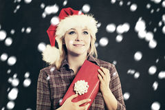 Happy Woman in Santa Hat with Christmas Gift Stock Photography
