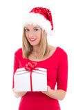 Happy woman in santa hat with gift isolated on white background Royalty Free Stock Image