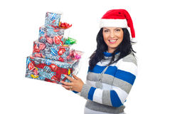 Happy woman in Santa hat with gifts Stock Image
